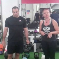 Quadruped Kettlebell Push for Core Stability
